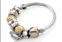 Charming / Life's a holiday! Celebrate each moment with Brighton's charm collection. All charms and bracelets seen here can be purchased at Ear Abstracts Boutique (714)996-3505