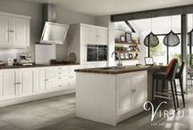 elegance | SERENE - Ivory Matt / The Serene Ivory Matt door gives a classic look with a contemporary twist, made using a traditional five-piece construction wrapped in a practical and durable material. Choose a walnut woodblock worktop to create a striking contrast and an even greater style statement.