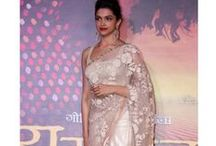 Deepika Ramleela Saree / Deepika padukone in designe cream netted saree. Designed by sabyasachi mukherjee at ramleela trailer first look launch. Teamed with simple lace border, decorated with mirrors through out the border. Embellished with self parshi work all over the saree. Paired with sleeveless matching blouse. Take a look at back round neck pattern knotted blouse.  Fabric Details : Saree : Net With Full Embroidery Blouse: Dhupian  Petticoat: Satin Work : Multi with Embroidery,Lace Work