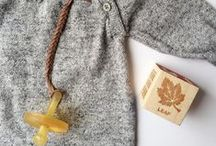 Madeline's Box Baby/Child Essentials / Leather braided pacifier clips. Emergency Contact Temporary Tattoos, wooden teethers, & Bibs and Natursutten Pacifiers.