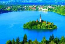 Lake Bled, Slovenia / Lake Bled features island church and castle perched on a cliff above it, against mountain backdrop of the Alps. A trip to Bled must be part of any tour to Slovenia.