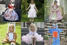 Dress up by Design- Travis Designs. / Dress up by Design- Travis Designs. The Travis Brands represents a mid to top end quality brand for the Toy, Gift and Children's wear markets worldwide. This exceptional collection boasts an array of choice for key dress up lines including princesses, fairies, knights, pirates and animals. There is something for everyone with the baby styles offering the cute factor and the wide range of costumes for boys and girls giving opportunity for creative adventures.