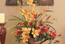 Floral Arrangements / Real or artificial...formal or casual...in a vase or a basket or a pitcher or a teacup...beautiful flower arrangements always brighten my day. Pin freely.  No limits. / by Irene Tice