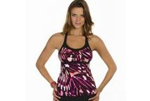Caribbean Joe / Beautiful women's swimsuits that come in a wide selection of tankini tops that you can mix and match to perfectly fit your skirt, briefs, or shorts.  Shop at eSunWear.com to find styles from Caribbean Joe bathing suits.