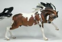 Horse Collection: Breyer, reworked and original models / I grew up collecting Breyer, Hartland and other model horses. Some collectors turn it into high art by repainting, repositioning and adding handmade gear... and sometimes whole scenes around their model. Here are some original models (Breyer, Schleich, Safari and others) as well as models done as fine art.