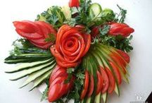 Vegetable carving / Vegetable carving is the art of carving vegetables to form beautiful objects, such as flowers or birds.
