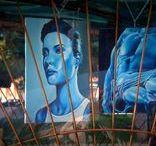 Taranto - Uno Spazio per l'Arte / In Piazza Garibaldi a Taranto, lo scultore, pittore, orafo Ettore Marchi ha realizzato una struttura con materiale di risulta, al fine di dare opportunità a numerosi giovani Artisti di mostrare in un luogo molto singolare e per molti versi anche provocatorio, le loro opere.