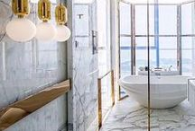 Bathroom Inspo / Dramatic and luxurious bathroom decor. Brass and gold fixtures and fittings, dark decor, marble and decorative floor tiles.