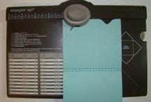 Envelope punch board.