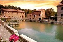 """Bagno Vignoni, Tuscany / The ancient village of Bagno Vignoni is located in the heart of Tuscany, in the Val d'Orcia Natural Park. These thermal waters were found and have been used since Roman times. At the heart of the village is the """"Square of Sources"""", namely a rectangular tank, of 16th-century origin, which contains the original source of water that comes from the underground aquifer of volcanic origins."""