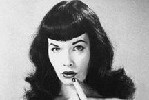 """Betty Page /  Bettie Mae Page (1923 – 2008) American model who became famous in the 1950s for her fetish modeling and pin-up photos. She has often been called the """"Queen of Pinups"""". Her look, including her jet black hair, blue eyes and trademark bangs, has influenced many artists. / by stephen"""