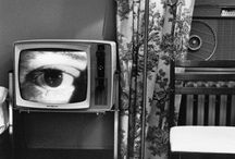 """[F] Lee Friedlander [1934 - ] / Lee Friedlander is an American photographer and artist. He was primarily active from 1960s and 1990s, working primarily with 35mm cameras and black and white film. Friedlander developed an influential and often-imitated visual language of urban """"social landscape."""" Many of his photographs include collage aspects, such as fragments of store-front reflections, structures framed by fences, posters, and street signs."""