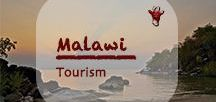 Malawi Tourism | Reisen / Malawi 'the warm heart of Africa' as the tourist board advertises is dominated by the third largest freshwater lake in Africa, Lake Malawi. Despite the uncontrolled growth of the population and related poverty Malawi is still quite safe to travel. The national parks are poor in wildlife as is fish in the Lake Malawi but the scenery is spectacular. Only be careful not to get stuck in a massive pothole or a weak bridge as the roads are pretty shocking.