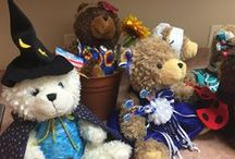 "Our Designer's Talent / Teddy Bears are ""dressed"" for the Houston Salvation Army to be given to children, to be sold to raise $$$ for other presents and to be part of a silent auction.  Our designer does 10+ bears every year.  The bear in the wheelchair with pink floral won a best in show designation!"