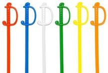"""Cocktail Swords / Our sturdy, """"Regal Sword"""" plastic picks provide a classic decorative touch to your sandwiches, appetizers, and drinks. With their traditional design and bright coloring, these 3"""" sword picks have one pointed end which is perfect for grabbing pickles, appetizers, and hors d' oeuvres. The sword handle makes them easy to hold."""