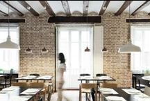 Oslo restaurant / Vegetarian restaurant in Valencia. Situated inside a 1850 building, the project looks for maximum respect and integration. A warm atmosphere leads every space, seeking little special places designed through the project.