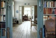 Bare floors, book shelves / Spare and beautiful spaces; rooms with bare wood floors and/or book sleeves.