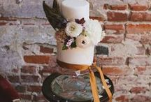 Sultry Antique Wedding Shoot / A brick/antique/watercolor wedding shoot steeped in glamor and dark passions featuring a watercolor wedding cake by Sainte G. Cake Company. Photographed in Oakland, CA  Cake: Sainte G. Cake Company Floral Design: Crimson Horticultural Rarities Jewelry: Esqueleto  Planning & Design: Jack & GingerStudios Photography: Two Foxes Photography Venue: Piazzaiolo, Oakland