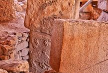 "Göbekli Tepe / Göbekli Tepe is the oldest megalithic structure on earth, predating Stonehenge by 6600 years and the Pyramids by 7100 years. Göbekli Tepe, or ""Potbelly Hill"" in Turkish, is possibly the most important archaeological discovery of this century."