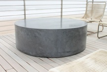 """Giant Roller / Custom made 48"""" diameter Rollerboy table, 16"""" tall with recessed exterior grade casters so the table glides around, even on the wooden deck. The surface is hand trowelled in a dark charcoal color."""