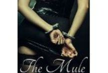 The Mule: An Erotic Romance in Colombia / Cleo can't believe it when Colombian customs find coke in her luggage or that Juan, her fiancé, instantly abandons her. When Connor offers to arrange for Cleo's release into his custody, Cleo is so desperate that she agrees. Living with Connor in his remote country home, Cleo evolves a plan to find Juan and explain it's all a huge misunderstanding. Will it work, or is Cleo on a path to disaster? http://www.amazon.com/dp/B00FYJDPBS