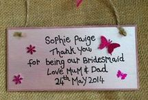 Bridesmaids Gifts / How do you thank the people who have helped you plan and prepare for your big day? Give them a keepsake that is personalised with the date and other key information so they can remember their part in it all, for years to come. From personal, handmade wooden wedding countdown plaques to thank you wordart photo frames, use your imagination and give them something they've never seen before…