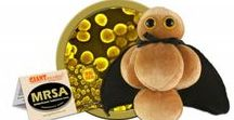 MRSA - Methicillin-Resistant Staphylococcus Aureus / You won't find this Superbug in the Halls of Justice. GIANTmicrobes are plush stuffed animals that look like tiny microbes - only a million times actual size! Gag and geek gifts, science, microbiology and biology toys for students, teachers, scientists, nurses and doctors - each coming with an image and information about the real microbe it represents. They make great educational learning tools as well as amusing gifts for anyone with a sense of humor.