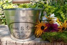 Bridesmaid and Flower Girl Gifts / Add a custom touch to your rustic wedding with these personalized metal buckets and pails. Made from pristine galvanized steel, they feature solid wood handles and wedding graphics. Fill them with flowers, favors, or use as table decor.