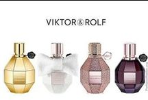 """Viktor & Rolf at Raw Beauty Studio / The first Viktor & Rolf fragrance, Flowerbomb, came out in 2004, to coincide with a women's Spring/Summer 2005 fashion collection also called """"Flowerbomb."""" They chose the name and designed the fragrance's distinctive """"hand grenade"""" bottle and gift-wrap packaging. Spicebomb for men was released in 2012"""
