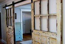 Interior Barn Doors / Using old Barn Doors as interior barn doors in modern homes.