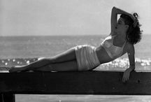 Style Icons in the Sun / Swimwear, swimming suits, swimming costumes with a vintage touch. Pin away your best suggestions for refined elegance at the beach both in black and white and technicolor!
