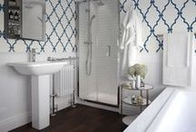 White & Bright / A bright space complemented with white and navy geometric trellis wallpaper provides a positive and fresh environment. Sleek, rectangular lines and soft curves are ideal for space restricted bathrooms, without compromising style.