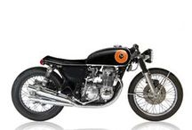 Café Racer Motorcycles / Café Racers originally emerged in 1960s Britain to define the stripped and modified motorcycles ridden by the counter-culture 'Rockers', who would ride these 'Café Racers' along predetermined routes at high speed against the clock.