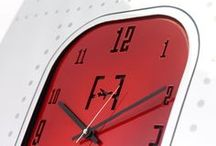 Boeing 737 - Fuselage Wall Art - Wall Clock - Candy Red / A unique piece of wall art, made from the fuselage of a Boeing 737, it has been entirely hand polished to a mirror finish. The clock face itself has been created by precision water cutting the original solid aluminium aircraft window. The frame behind has been powder coated with to a gloss finish.