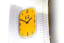 Boeing 737 - Fuselage Wall Art - Wall Clock - Yellow / A unique piece of wall art, made from the fuselage of a Boeing 737, it has been entirely hand polished to a mirror finish. The clock face itself has been created by using precision water cutting to cut the clock numbers from a solid aluminium aircraft window.The frame behind has been powder coated to a gloss finish