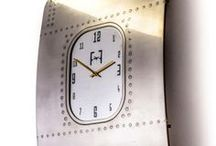 Boeing 737 - Vintage Fuselage Wall Art - Wall Clock - Gold / A unique piece of wall art, made from the fuselage of a Boeing 737, it has been entirely hand polished to a vintage finish. The precision water cut, authentic, solid aluminium clock face has been mirrored polished. The frame behind has been powder coated to a gloss finish.