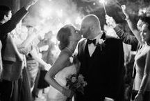 Wedding Exits / The newly minted bride and groom exiting their wedding celebration. Wedding exits featuring wedding exit ideas, wedding exit send offs, wedding exit songs, wedding exit bubbles, nighttime wedding exits, wedding exit streamers, wedding exit confetti, wedding exit sparklers, and wedding exit dresses.