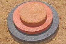 """Round Patio Stones / St. Vrain Block makes round pavers in 24"""", 18"""", and 12"""" sizes with colors including Gray, Red, Tan, and Black.  The exact thickness is 21/8"""" of our pavers making them extremely durable and increases their lifespan.  We manufacture all products on site at 5150 Grand View Blvd. Dacono, Co. 80514.  Call us @ 303-833-4144 or find us online at www.stvrainblock.com"""