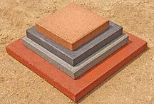 """12"""" Concrete Patio Stones / These are very popular for patios, stepping stones, and a mix of other creative projects. The pavers are 12"""" x 12"""" x 2 1/8"""" and weigh 23 lbs a piece.  They are available in smooth top & paver top (a brick stamped option) varieties.  St Vrain Block is located at 5150 Grand View Blvd. Dacono, CO. 80514. 303-833-4144"""