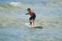Keiki (Kids) Surfing / There's nothing like watching one of the kids catch their first wave. We specialize in making family vacations special.