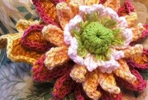 crocheting flowers / to be honest , not only crocheted flowers,but any kind exept real ones..... / by Kaiti Theodoridou