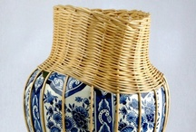 Pronkstuk (Centerpiece) / Centerpiece is series of sculptural vases with a combination of two traditional Dutch crafts. A combination of fragmented Delfts Blue vases with beautifully hand crafted wicker braiding. Filling in the missing parts of the fragmented vase by elegantly combining the two materials which are visible by contrast.