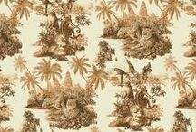 SUMATRA / Sumatra depicts a mystical scene of the palmed jungle temples of Indonesia. At its forefront is the magnificent Sumatran tiger, gazing out across his kingdom. Inspired by the great French toile de jouey patterns of the late 18th century. This intricate, dual tone illustration is at once epic and soft, featuring a colour palette of bronze, silver, bluestone and olive green options. A traditional style design that will conjure a mood for travel and nature through your interiors.