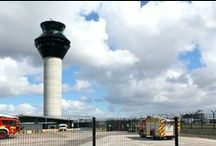 Manchester Airport Control Tower, Society Awards 2013, Bldg Category (Mixed Use), Commendation / A new control tower has been constructed at Manchester Airport. This is located at a site away from the terminal buildings, adjacent to the airport fire station. The building consists of low-rise ground-level buildings around a high tower structure. The main part of the building consists of a slipformed concrete tower.