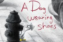 A Dog Wearing Shoes / A collection of photos of adorable dogs in shoes. Inspired by A DOG WEARING SHOES by Sangmi Ko.  / by Random House Children's Books