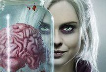 izombie / When over-achieving medical resident Liv Moore attends a party that turns into a zombie feeding frenzy, she ends up joining the ranks of the living dead. Determined to pass as human despite her pale appearance and newly listless demeanor, Liv forms a plan to resist her drive to consume fresh human brains by taking a job at a coroner's office, where she can secretly snack on the brains of corpses delivered there.