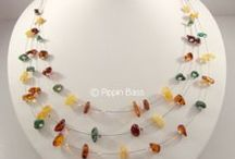 Amber Silver Necklaces / Trendy amber, pearl, and silver bead necklace. A charming design! Our designs are individually handcrafted and brought to you directly from the manufacturing facilities.