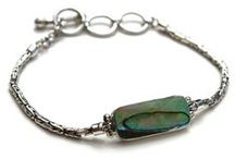 Abalone Jewelry / The colorful abalone shells are from New Zealand, where they are called paua shells. They shimmer in striking blue, purple, green and pink colors. A true marvel of nature, the abalone shells look just like the ocean they come from. All our abalone jewelry is handmade and set in sterling silver.
