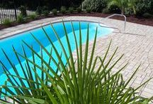Beautiful Pools / pool decks, pool surrounds, pool retaining walls all designed and installed by Yardworks, Inc.
