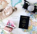 travel flat lays / passports, train tickets, air plane tickets, sunglasses, maps, etc.